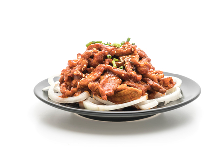 fried pork with spicy korean sauce (bulgogi) isolated on white background Reklamní fotografie