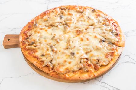 mushroom pizza with miso sauce on table
