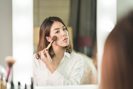 Asian girl in mirror