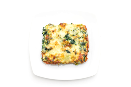 baked spinach with cheese isolated on white background Фото со стока