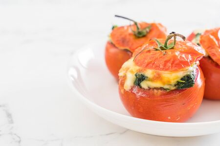 baked tomatoes stuffed with cheese and spinach  - healthy food style