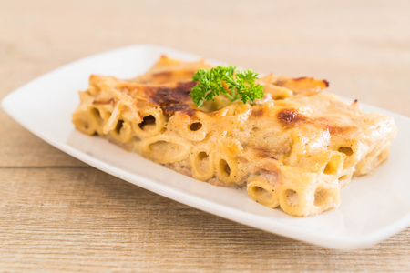 baked penne pasta with cheese and ham - Italian food style