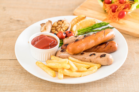 grill: grilled sausage with vegetable on plate Stock Photo
