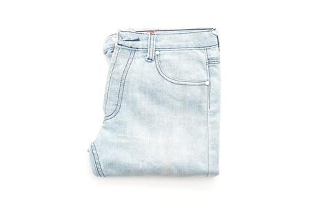 blue background: jeans folded isolated on white background