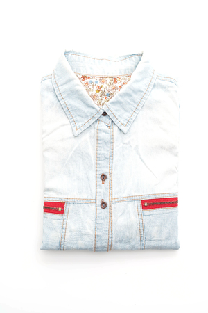 blue background: folded shirt isolated on white background