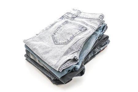 blue background: stack of jeans folded isolated on white background Stock Photo
