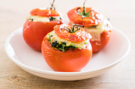 red quinoa: baked tomatoes stuffed with cheese and spinach  - healthy food style