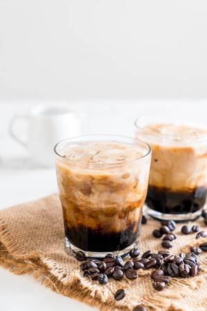 Iced coffee with milk on the table