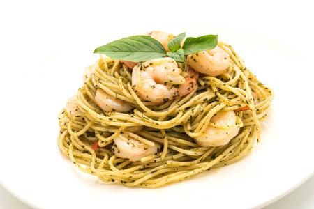 pasta spaghetti with pesto green and shrimps isolated on white background Stock Photo