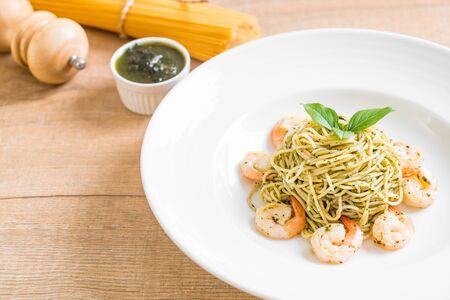 pasta spaghetti with pesto green and shrimps - Italian food style