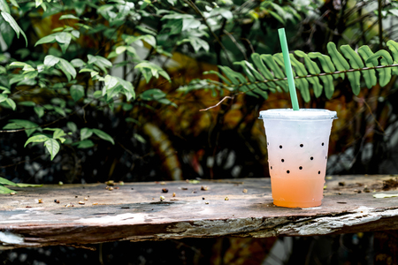 glass of lychee soda with tree background Stock Photo