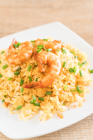 fried rice with shrimps on white plate Stock Photo