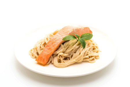 spaghetti cream cheese white sauce with salmon isolated on white background