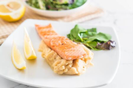 grill: grilled salmon steak with mash potato and vegetable salad Stock Photo