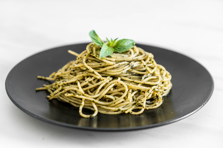 Spaghetti with basil pesto - Italian food style Stock Photo