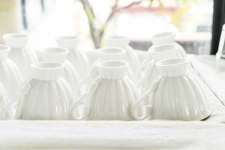 Stack of clear coffee cup bottom up - selective focus point Stock Photo