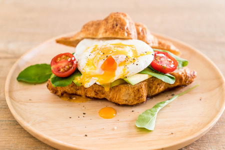 benedict: egg benedict with avocado, tomatoes and salad - healthy or vegan food style