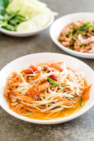spicy papaya salad (Traditional Thai food) on the table