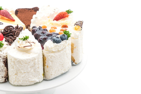 different pieces of cake isolated on white background