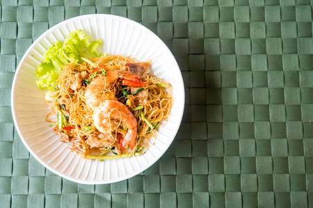 fried white vermicelli and water mimosa with spicy sauce and shrimps