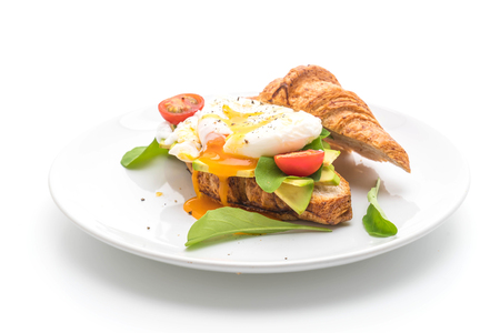 benedict: egg benedict with avocado, tomatoes and salad - healthy or vegan food style - isolated on white background Stock Photo