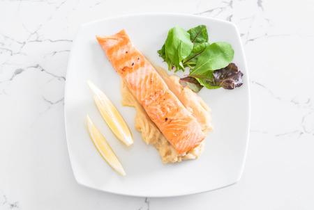 grilled salmon steak with mash potato and vegetable salad Stock Photo