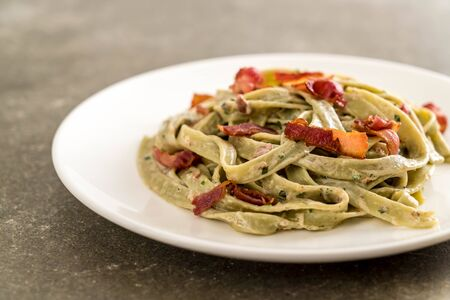 spinach fettuccini pasta with bacon - Italian food style