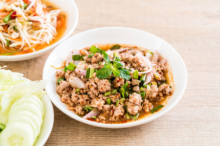 spicy mince pork (Larb - Traditional Thai Food) on the table Stock Photo