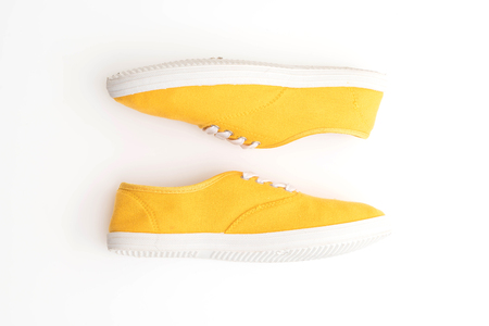 yellow sneakers isolated on white background
