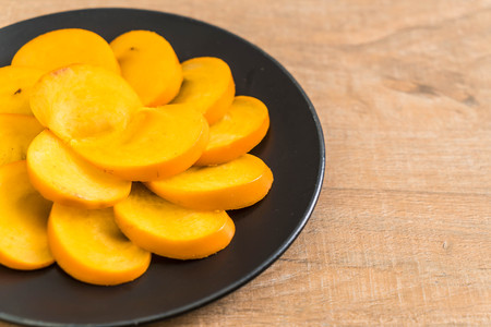 sliced fresh persimmon on plate