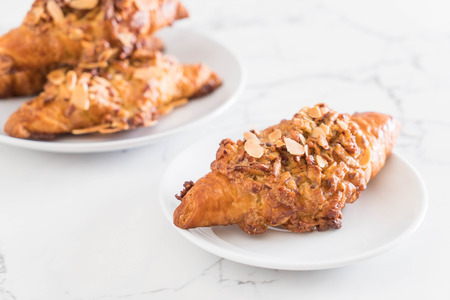 fresh baked croissant with almonds Stock Photo