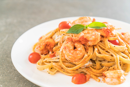 delicious spaghetti with shrimps, tomatoes, basil and cheese - italian food style