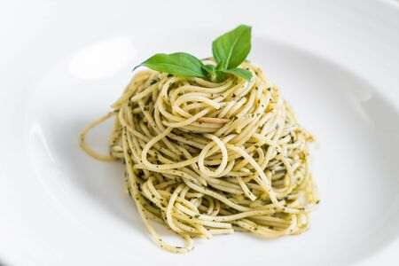 pasta spaghetti with pesto green sauce and basil - Italian food style