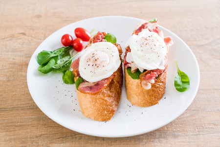 egg benedict on white plate