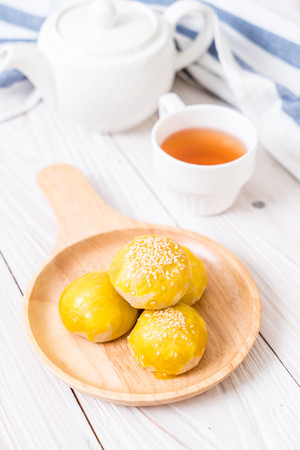 Chinese pastry or moon cake filled with mung bean paste and salted egg yolk - Asian dessert Stock Photo
