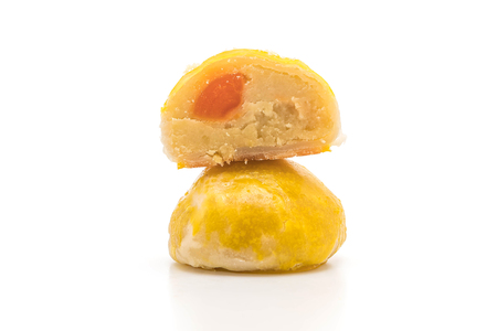 Chinese pastry or moon cake filled with mung bean paste and salted egg yolk isolated on white background