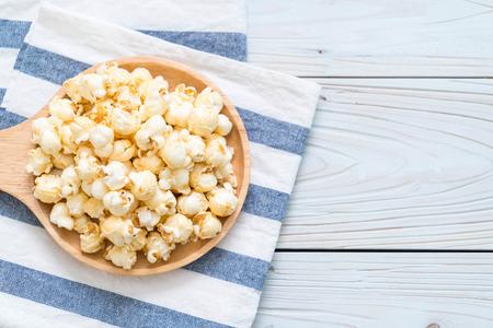 sweet popcorn on wood background