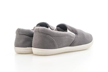 grey sneakers isolated on white background 版權商用圖片