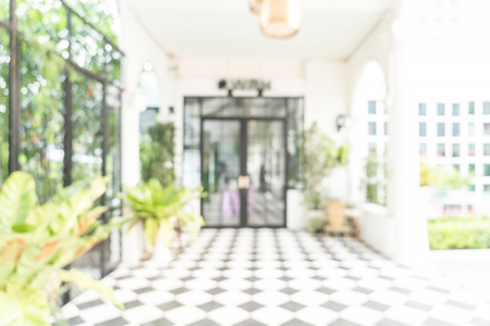 Blurred abstract background of modern interior view looking out toward to empty office lobby and entrance doors