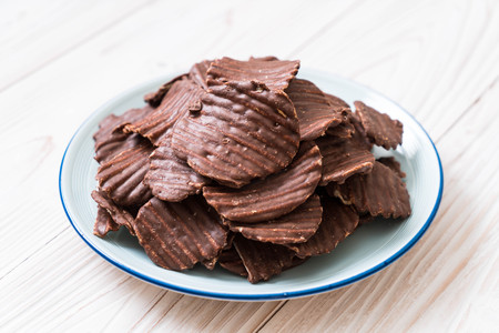 potato chips with chocolate on plate Banco de Imagens