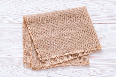 kitchen cloth (napkin) on wood background with copy space Foto de archivo