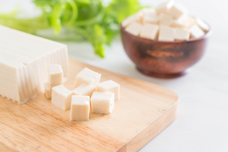 cube tofu on wooden board background