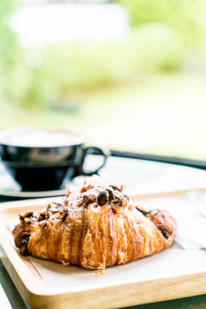hazelnut croissant with hot coffee for breakfast