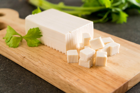 cube tofu on wooden board background Stock fotó - 92556495