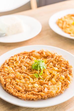 omelet or fried beaten egg on plate