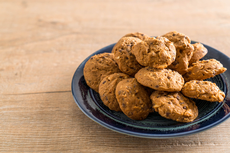 chocolate chips and cashew nut cookies on plate Stock Photo