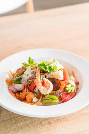 Spicy vermicelli and seafood salad on plate Stock Photo