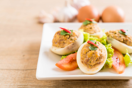 boiled egg with minced pork on plate Stock Photo