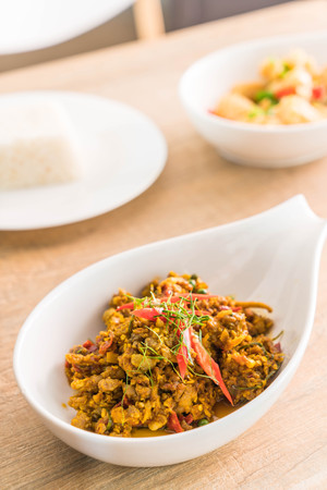 Stir Fried Minced Pork with Hot Yellow Curry Paste on plate