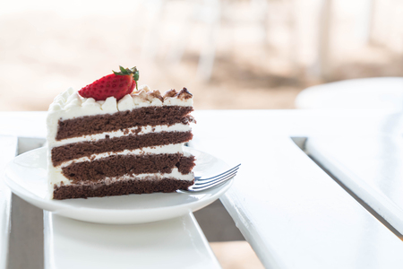 vanilla and chocolate cake with strawberry in cafe